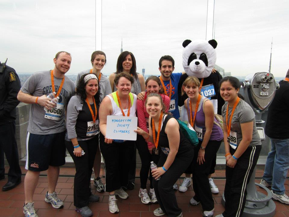 Manhattan Society Climbers pose at the 2012 Climb to the Top event-- panda suit and all.